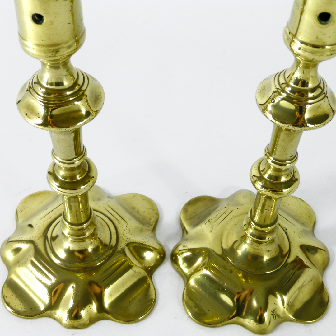 Pair of English Shaped Cast Brass Petal Base Candlesticks. Circa 1750