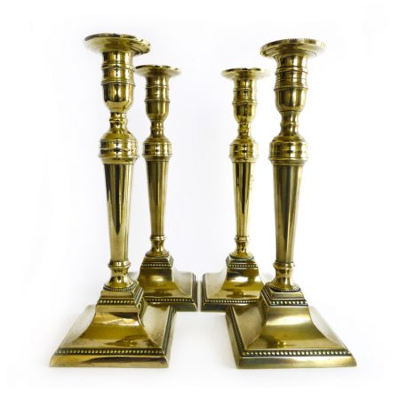 A Rare Set of Four English Brass Candlesticks with Beaded Decoration. Circa 1785.