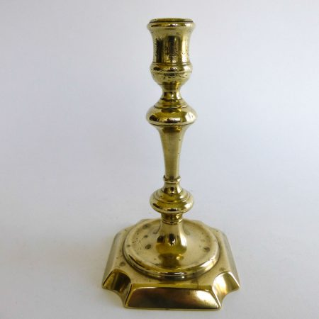 English Brass Queen Anne Single Candlestick. Circa 1740.